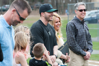 04/13/18  Wesley Bunnell | Staff  Daughter of Paul Baretta Andrea Baretta-Maule, 2nd from R, stands next to her husband and assistant coach at NW Catholic Jason Maule and their children as well as Mayor Mark Kaczynski, far R, during the dedication of the Paul Baretta baseball field. The Town of Berlin dedicated Paul Baretta Field at Percival Park on April 13th before the Berlin High School baseball game vs Northwest Catholic.
