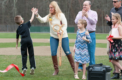 04/13/18  Wesley Bunnell | Staff  Daughter of Paul Baretta, Andrea Baretta-Maule, high fives her son Trey during a ribbon cutting ceremony for Paul Baretta Field while daughter Nerea, 3rd from r, looks on. The Town of Berlin dedicated Paul Baretta Field at Percival Park on April 13th before the Berlin High School baseball game vs Northwest Catholic.