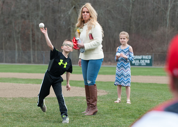 04/13/18 Wesley Bunnell | Staff Grandson of Paul Baretta, Trey Maule, throws out a ceremonial first pitch while standing next to mom Andrea Baretta-Maule and sister Nerea. The Town of Berlin dedicated Paul Baretta Field at Percival Park on April 13th before the Berlin High School baseball game vs Northwest Catholic.