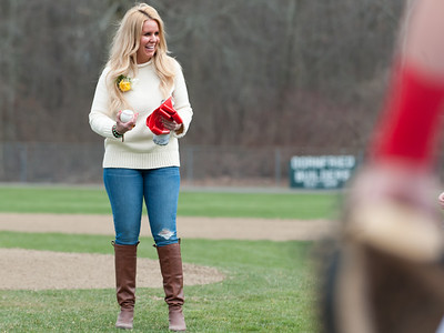 04/13/18  Wesley Bunnell | Staff  Andrea Baretta-Maule holds a baseball before the dedication of a baseball field in her fathers honor. The Town of Berlin dedicated Paul Baretta Field at Percival Park on April 13th before the Berlin High School baseball game vs Northwest Catholic.