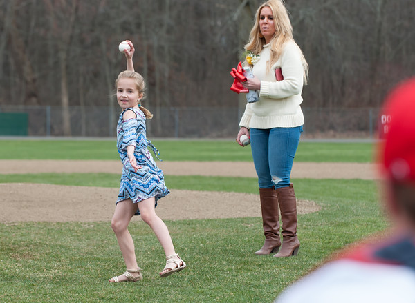 04/13/18 Wesley Bunnell | Staff Granddaughter of Paul Baretta, Nerea Maule, throws out a ceremonial first pitch while standing next to mom Andrea Baretta-Maule. The Town of Berlin dedicated Paul Baretta Field at Percival Park on April 13th before the Berlin High School baseball game vs Northwest Catholic.