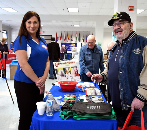 4/14/2018 Mike Orazzi | Staff Polish Helping Hands' Mariola Badzioch talks with Bob Badal during the Prime Time Senior Fair held at Bristol Eastern High School Saturday.