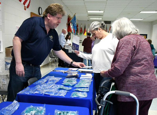 4/14/2018 Mike Orazzi | Staff Bristol Hospital's Chris Boyle talks with Shari and Phyllis Sharasheff during the 4th annual Prime Time Senior Fair held at Bristol Eastern High School Saturday.