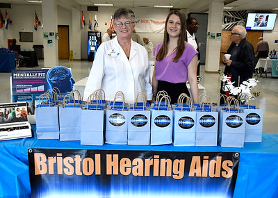 4/14/2018 Mike Orazzi | Staff Bristol Hearing Aids'  Joanne Cyr and Miranda LaPira during the Prime Time Senior Fair held at Bristol Eastern High School Saturday.