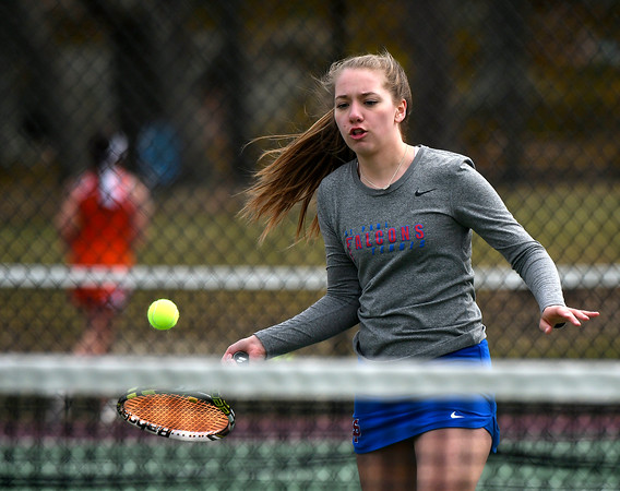 4/18/2018 Mike Orazzi | Staff St. Paul's Caroline Badal during Wednesday's tennis match with Watertown in Page Park.