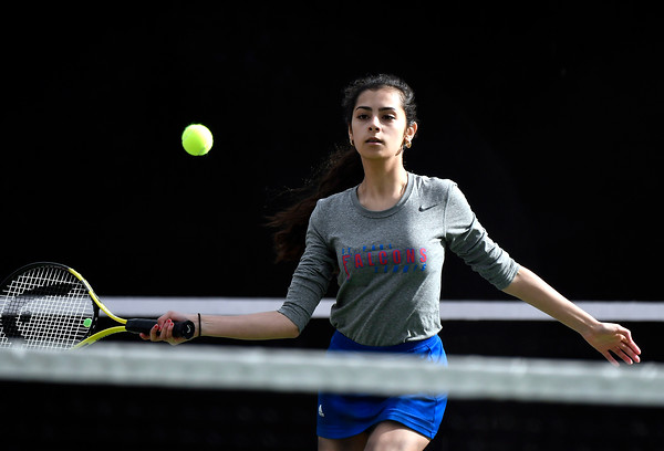 4/18/2018 Mike Orazzi | Staff St. Paul's Violet Rodriguez in a doubles match during Wednesday's tennis match with Watertown in Page Park.