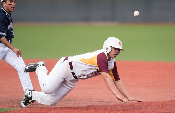 04/18/18 Wesley Bunnell | Staff New Britain baseball defeated Hartford Public on Wednesday night in a game played at CCSU. Ruffino Santiago (16) attempts to slide back into first but would be ruled out.