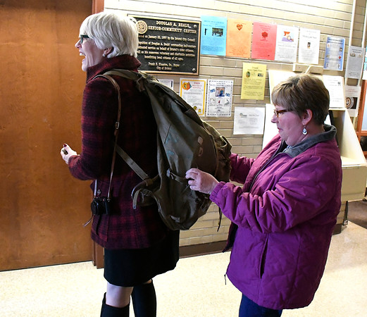 4/20/2018 Mike Orazzi | Staff Helen Ayer Patton shows off a World War II backpack to Judy Kirschner that belonged to her father Herman James Perry.