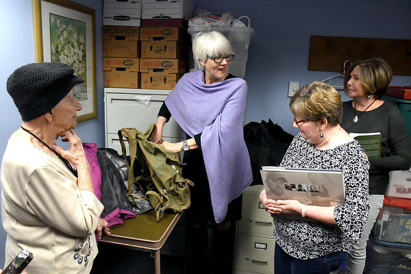 4/20/2018 Mike Orazzi | Staff Helen Ayer Patton returns Herman James Perry's World War II backpack to Dorothy Perry and her daughters Cheryl Chumney and Judy Kirschner at the Bristol Senior Center Friday.