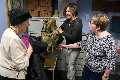 4/20/2018 Mike Orazzi | Staff A World War II backpack that belonged to Herman James Perry after it was returned to Dorothy Perry and her daughters Cheryl Chumney and Judy Kirschner at the Bristol Senior Center Friday.