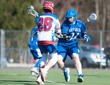 04/20/18  Wesley Bunnell | Staff  Berlin boys lax defeated Bristol Eastern 18-3 on Friday afternoon at Sage Park. Brian Formica (26) and Ethan Mathieu (27).