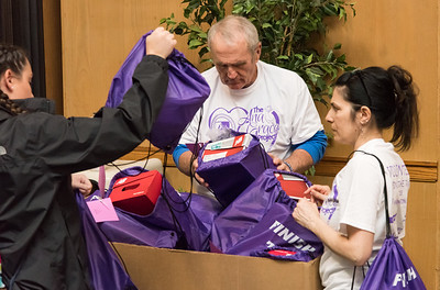 04/27/18  Wesley Bunnell | Staff  The CCSU Ana Grace Project held Love Wins: Finish the Race on Friday to give young middle school students from across New Britain a college experience for the day and have them explore their possibilities. CCSU volunteers included many student athletes. Teachers and CCSU volunteers sort through the backpacks filled with sneakers, pencils, a yoyo and water bottle to give to the students.