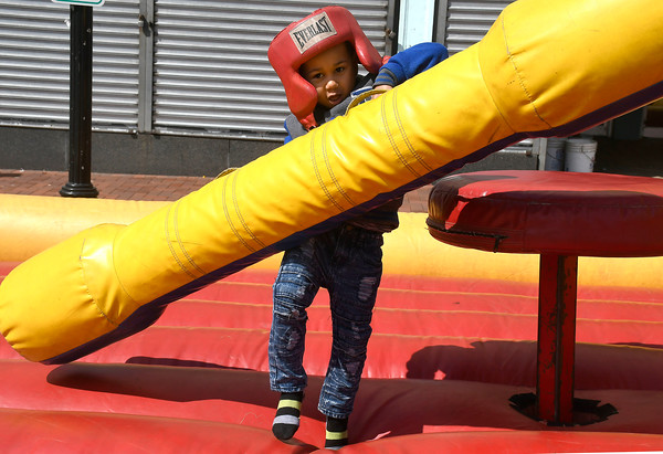 4/28/2018 Mike Orazzi | Staff Diosiel Martinez,5, struggles during the annual Hoops for Homeless in downtown New Britain.