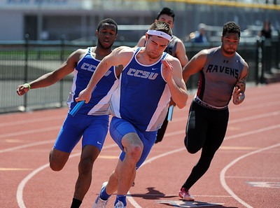 4/28/2018 Mike Orazzi | Staff Central Connecticut University's Miles Fye-Moore and Tyler Latham in the 4 x100 during the CCSU Innovational Track Meet Saturday in New Britain.