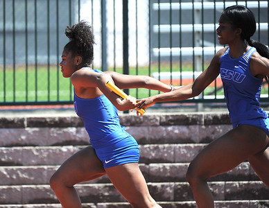 4/28/2018 Mike Orazzi | Staff Central Connecticut University's Erica Snape and Melissa Wolliston in the 4 x100 during the CCSU Innovational Track Meet Saturday in New Britain.