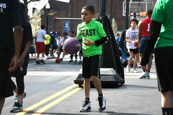 4/28/2018 Mike Orazzi | Staff Northend School's Derrick Sanchez during the annual Hoops for Homeless in downtown New Britain.