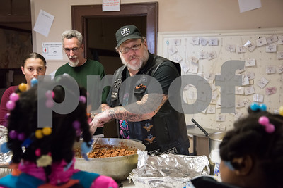 04/06/18  Wesley Bunnell | Staff  Andrianna Baez , L,  stands next to St. Mark's Church Sexton Kelly Naus as fellow volunteer Bernie Boucher, R, helps to serve meals to the hungry at the church on Friday evening. The church which is located on W. Main St in New Britain holds a feed the hungry dinner every Friday from 5-6pm for approximately 70-100 individuals relying in large part to donations from the community.