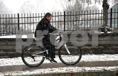 4/6/2018 Mike Orazzi | Staff A snowy bike ride along Route 6 in Bristol Friday afternoon.