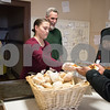 04/06/18  Wesley Bunnell | Staff<br /> <br /> Morelle Warner, L, watches as fellow volunteer Andrianna Baez  serves a plate of food during a feed the hungry dinner on Friday evening. St. Mark's Church Sexton Kelly Nauss looks on, middle, as volunteer Bernie Boucher, R, starts to prepare another plate. Warner, known affectionately as Momma, prepares most of the meals the church serves every Friday from 5-6pm for approximately 70-100 individuals relying in large part to donations from the community.