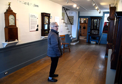 4/7/2018 Mike Orazzi   Staff Angie Parson while looking over clocks on the opening day of the American Clock & Watch Museum in Bristol Saturday.