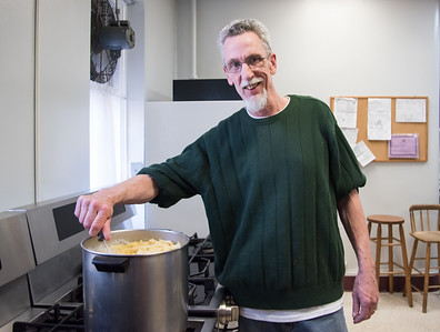 04/06/18  Wesley Bunnell   Staff  Kelly Nauss, Sexton of St. Mark's Church, stirs a large pot of pasta in the church's kitchen on Friday evening. The church which is located on W. Main St in New Britain holds a feed the hungry dinner every Friday from 5-6pm for approximately 70-100 individuals relying in large part to donations from the community.