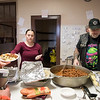 04/06/18  Wesley Bunnell | Staff<br /> <br /> Andrianna Baez , L,  volunteers to serve the hungry at St. Mark's Church alongside of Bernie Boucher on Friday evening. The church which is located on W. Main St in New Britain holds a feed the hungry dinner every Friday from 5-6pm for approximately 70-100 individuals relying in large part to donations from the community.
