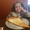 Giant piece of pizza. six bites in, and it took out her loose front tooth, which she swallowed.