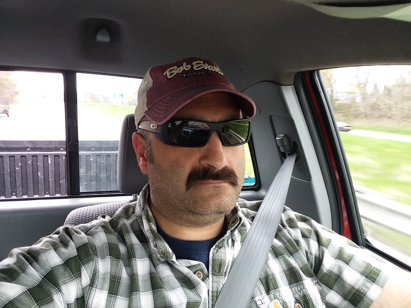 Truck driving selfie!  I'm leaving Cleveland and heading south, to Dover, to meet Meredith.<br /> <br /> Notice my Bob Evans hat.  All my other hats burned up in our recent fire so I have been on a mission to acquire a few new ones, and this one seemed right up my alley.  Obviously wearing a Bob Evans hat in Ohio would be super lame; but in California no one knows what the fuck Bob Evans is, so it's trendy and cool - two words most commonly used to describe me.