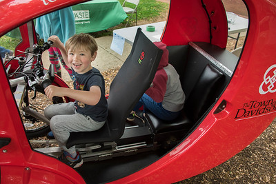 Not yet old enough to drive, but he's eager to try out the town's electric vehicle. [Bill Giduz photo]