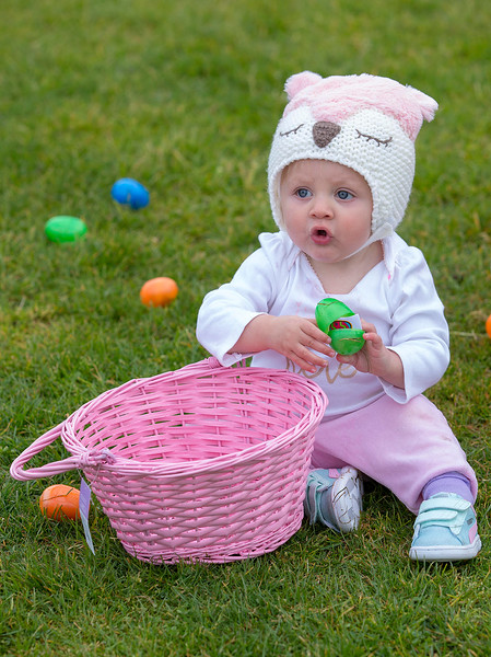 MacKenzie Casey reacts after picking up an egg during the annual Easter Egg Hunt at Jacks Park in Monterey on Saturday April 20, 2019. Casey turned one year old on Saturday. (David Royal/ Herald Correspondent)