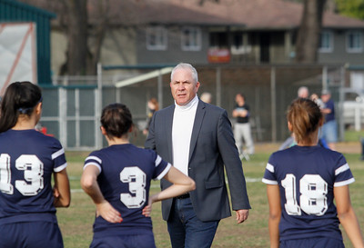 Brett Silva Pleasant Valley's coach talks with the players Claire Morrison (13), Lili Salinas (3) and Bianca Abara (18) during a soccer game against Chico High on Feb. 10, 2016. (Emily Bertolino -- Enterprise-Record File)