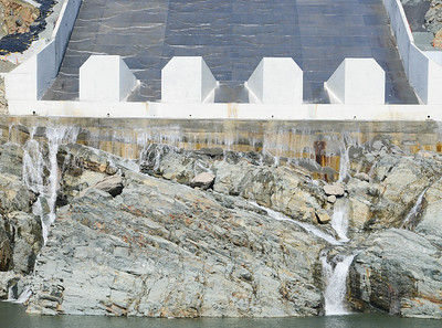 Water trickles down the Oroville Dam spillway Wednesday in Oroville.  (Matt Bates -- Enterprise-Record)