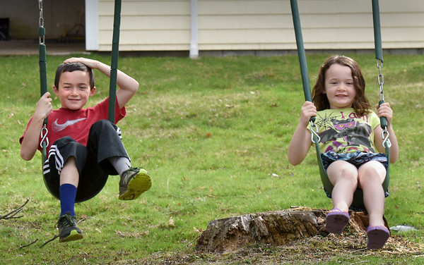 BRYAN EATON/Staff Photo. Newburyport siblings Jackson Webber, 8, left, and Colleen, 5, play in their back yard.