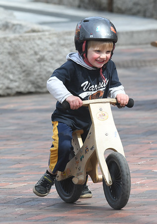 JIM VAIKNORAS/Staff photo Anderson Boyd, 3, of Amesbury smiles as he rides his bike on Inn Street in Newburyport Friday afternoon.