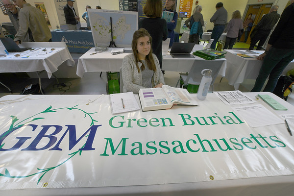 JIM VAIKNORAS/Staff photo Kat McCarron, a student at NECC talks about represents Green Burial Massachusetts at the Green Expo at the Nock Middle School in Newburyport Thursday night.