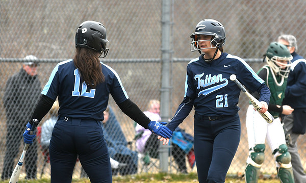 JIM VAIKNORAS/Staff photo Triton's Emily Karveilis #12, congratulates teammate Grace McGonagle after she scored    against Pentucket at Triton Friday.