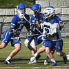 BRYAN EATON/Staff Photo. Georgetown's Matt #22 is swamped with Methuen defenders.