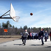 BRYAN EATON/Staff Photo. Sixth-graders at Salisbury Elementary School enjoyed Tuesday's 50 degree weather playing basketball at recess. After some rain and a touch of snow possible on Wednesday morning, nicer weather returns.