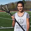 BRYAN EATON/Staff Photo. Triton freshman Kate Trojan plays on the varsity lacrosse team.