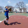 JIM VAIKNORAS/Staff photo Dwayne Blake Jr. 10 , of Salisbury cast a shadow in the sunshine Saturday as he shoots around in Cashman Park in Newburyport.