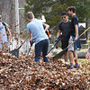 BRYAN EATON/Staff Photo. Members of the Georgetown High School boys lacrosse team recently did a cleanup of the Merrimack Cemetery on Pleasant Street in West Newbury. Their coach, Terry Hartford, lives in town and has cleaned the cemetery on occasion and enlisted his willing players to help out as part of community service and building teamwork.