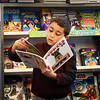"BRYAN EATON/Staff Photo. Markus Cartagena, 6, checks out the book ""The World's Cutest Puppies in 3-D"" in the library at the Bresnahan School during a preview session. The school is holding a Book Fair starting today until Saturday morning."