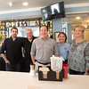 JIM VAIKNORAS/Staff photo West Row owner Dave Pierre, center, is flanked by chef Peter Bond and bartender Vaughn Abbott on the left and waitress Weezie Gross and manager Anne Upton on their last day Saturday..