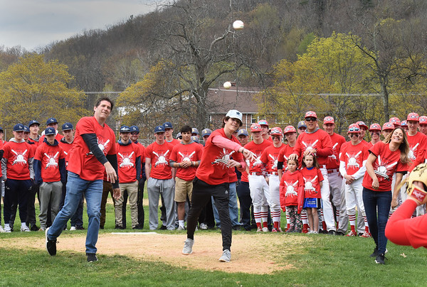 BRYAN EATON/Staff photo. Troy's family threw the ceremonial first pitches, from left, dad Scott, brother Nick and mom, Lisa.