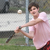 JIM VAIKNORAS/Staff photo Shea McLaughlin, an 8th grader at Triton, plays Homerun Derby at the Byfield Little league Park Friday afternoon.