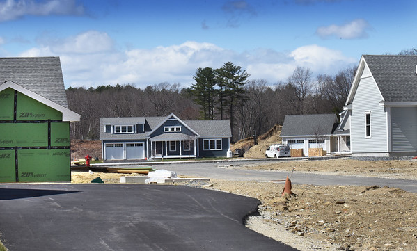 BRYAN EATON/Staff Photo. Homes at Evergreen Commons on Boyd Drive in Newburyport are under various stages of construction. The property is the old Evergreen Golf Course and is near a source of water wells for the city.