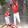 JIM VAIKNORAS/Staff photo Amesbury's Derek Douherty goes high to field a throw as Newburyport's Ryan Archie steals second at Pettingell Park in Newburyport Friday.
