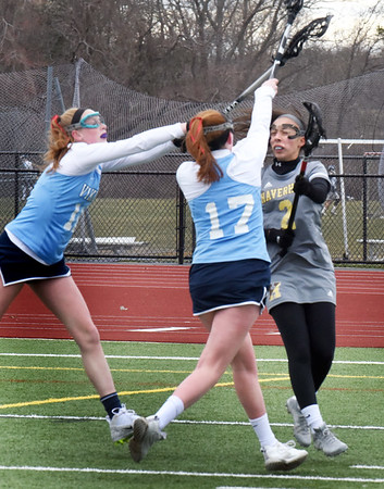 BRYAN EATON/Staff Photo. Triton's Kerry Power, left, and Erin Power put the pressure on a Haverhill player, #2.