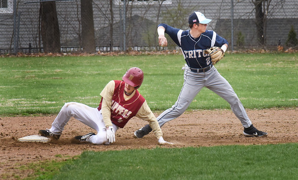 BRYAN EATON/Staff Photo. After forcing Tyler Koglin out at second, Triton shortstop Devin Parsons tries to make it a double play.