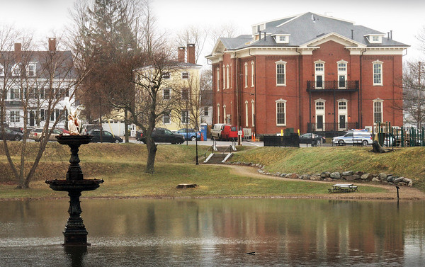 BRYAN EATON/Staff Photo. The stump of willow tree, at center of photo, at Newburyport's Bartlet Mall has been taken down along with other trees around the Frog Pond.